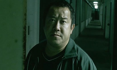 Eric Tsang dans la saga Infernal Affairs