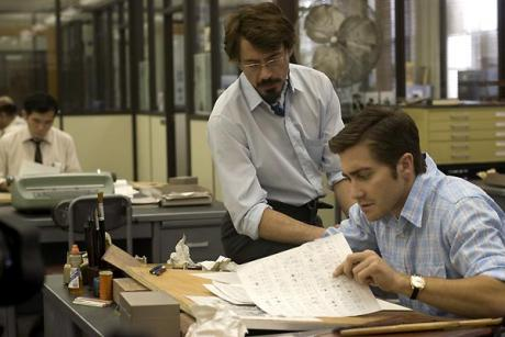 Grayson (Jake Gyllenhaal) et le journaliste Paul Avery (Robert Downey Jr.)
